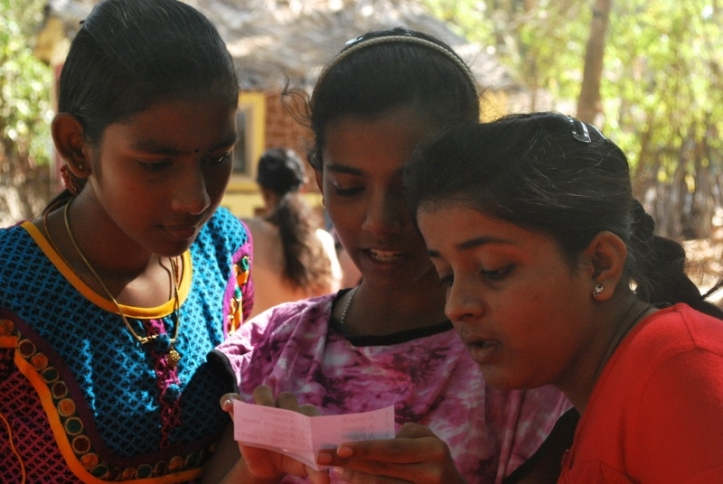 Arul, Anupa and Iram check the list of items they have to find