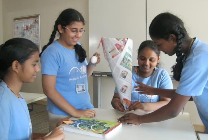 Arul, Sejal, Ashwini and Nikita experiment with a funnel device