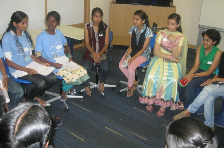 Sayra and Kency facilitate a discussion group