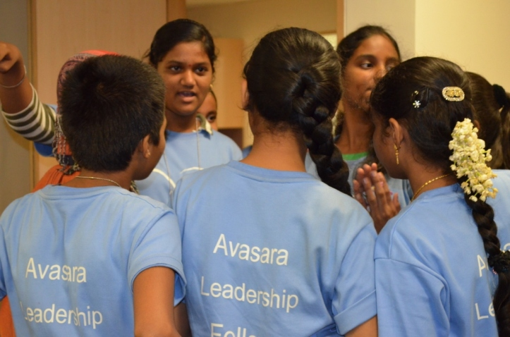 Ankita shares her ideas with her team.