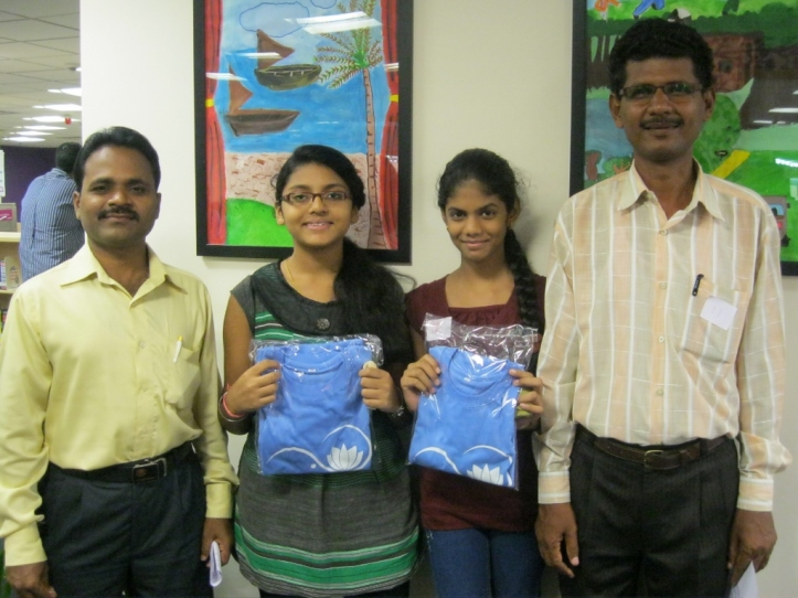 Two new Avasara Leadership Fellows, Megha and Sneha, with their proud fathers.