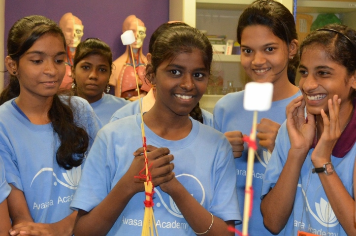 Monica, Varsha, Priya, Mitali and Aishwarya compare the heights of two completed structures