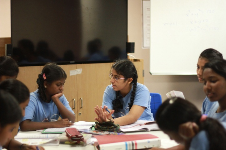 Sejal and Yamuna discussing a maths problem