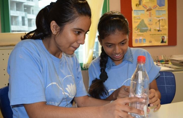 Divya and Alisha figure out how the Cartesian Diver works