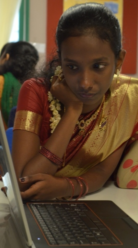 Sweety demonstrates classic South Indian style whilst using her laptop!