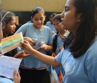 Girls stuffing the notes into envelopes which ensured they arrived in the right classroom