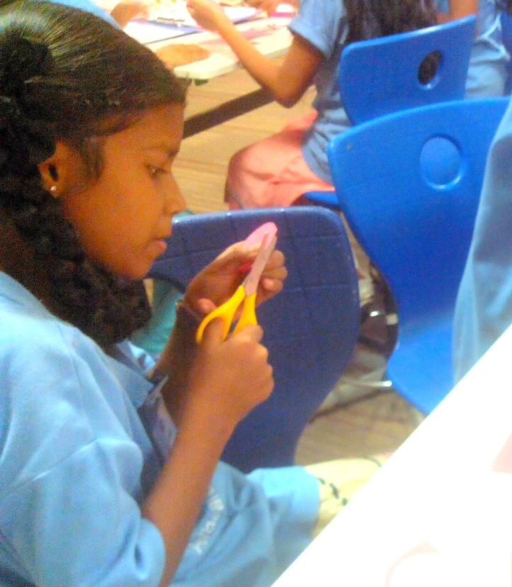 Sayali busy cutting a circle out