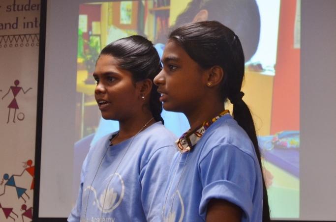Jeniba and Usha Rani presenting at an ALF function