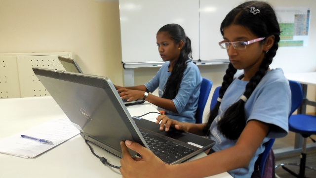 Afsana and Reshma working on their presentations