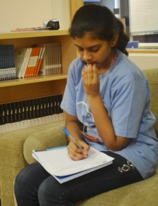 Jhanvi writing a reflection.