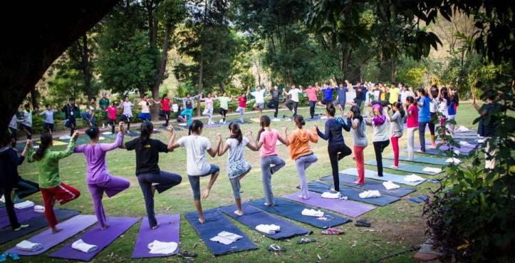 Students practicing Acro Yoga at TSALS