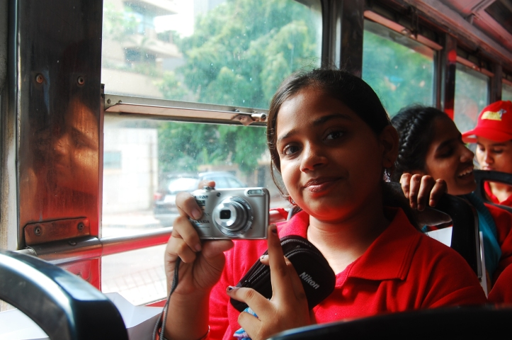 Vinisha posing with her camera.