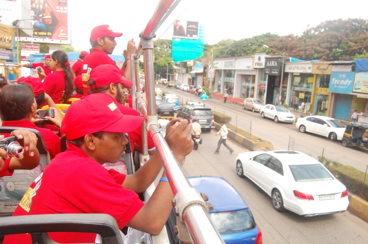 Students clicking picture from the top of the bus.