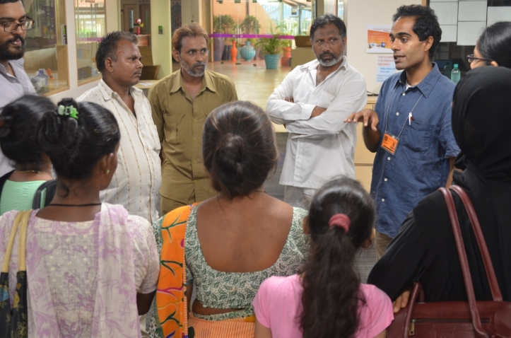 Rickshaw drivers, teachers and parents discuss travel arrangements