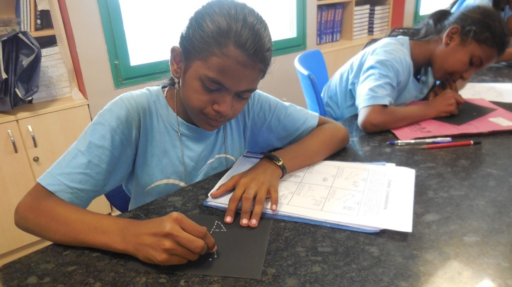 Shruti busy in drawing a constellation