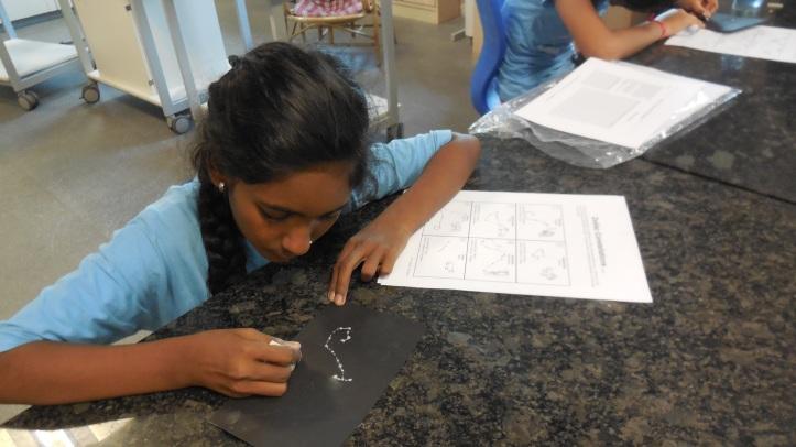 Fatima drawing a constellation
