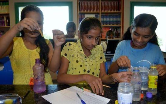 Suhana, Saima and Nisha testing their rainwater samples.