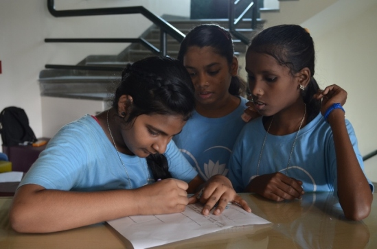 Chhaya, Firdosh and Kajal work on their research question.  They ended up studying the biodiversity level in BKC.