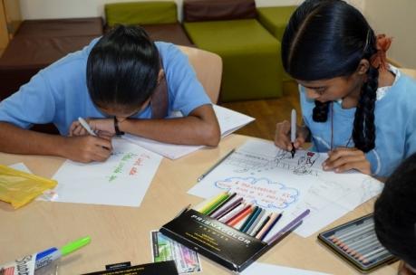 Girls working to illustrate their haikus