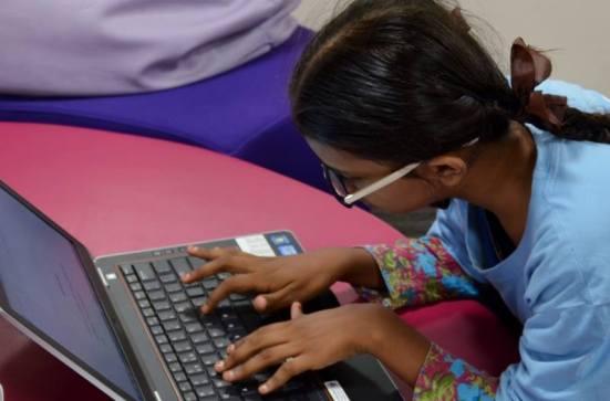 Sumaiya working away on her paper.