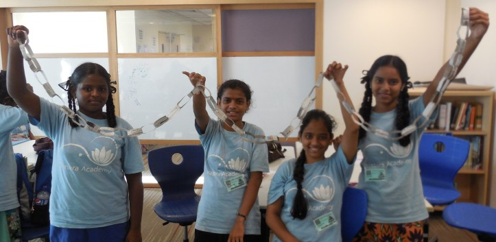 Selvi, Vedangi, Shofiya and Soni holding up the longest chain.,